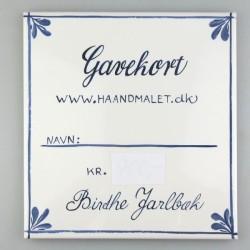 Gavekort med et beløb efter eget valg skrevet på en håndmalet flise